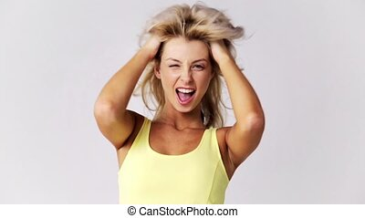 happy smiling beautiful young woman touching hair -...