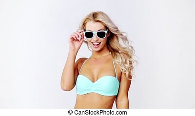 happy woman in bikini swimsuit with sunglasses - people,...