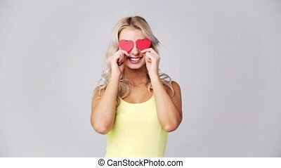 happy young woman with red paper hearts - love, romance,...