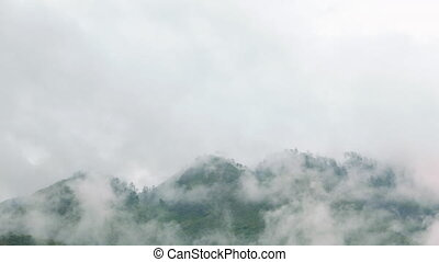 Mountian Peak in the Clouds - Small scattered clouds running...