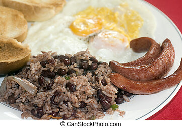 breakfast in Nicaragua gallo pinto eggs sausage - typical...