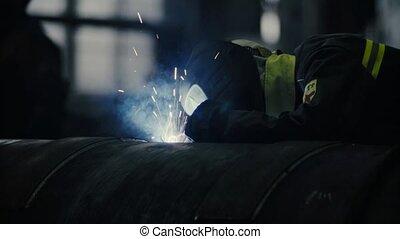 Welder at work in metal industry - Close up of welding....