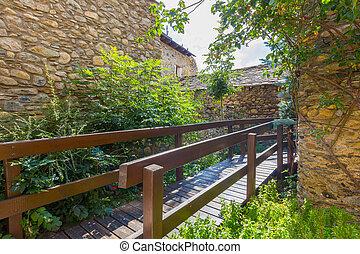 Wooden walkway between stone houses
