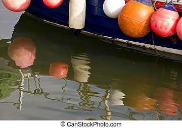 Buoy Reflections - Side of a fishing boat festooned with...