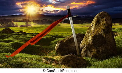 Sword in the dramatic sunny landscape. - Sword with red...