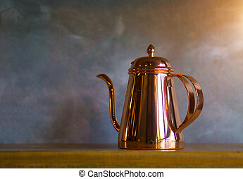 Copper coffee pots on wood shelf for home interior.