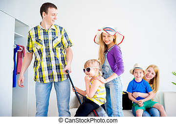 Family packing suitcases - Happy family packing suitcases...