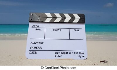 Maldives beautiful beach background white sandy tropical paradise island with blue sky sea water ocean 4k clapperboard film slate director action cut