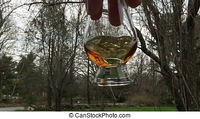 Whiskey swirling in whiskey glass 2 - This video is about...