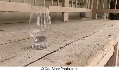 Empty whiskey glass on old bench - This video is about Empty...