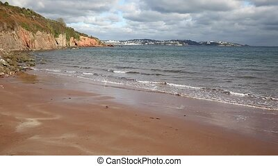 View of Devon beach sea and coast towards Torquay England UK
