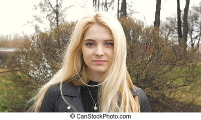 Portrait of a beautiful sexy girl with blond hair, happy...