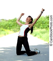 Portrait of an excited young sportswoman rejoicing winning