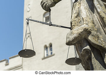 Closeup of the Justitia well in Regensburg with scales in...