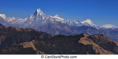 Machapuchare and other mountains of the Annapurna range on a...