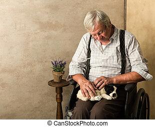 Dog with elderly man