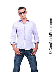 young man in jean - A young man in jeans and a light shirt...
