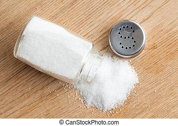 salt shaker - photo shot of salt shaker on wooden table