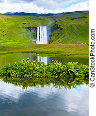 Waterfall Skogafoss reflected in pond - Abounding waterfall...