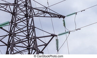 Power lines. Insulation of high voltage wires. Reading renewable energy. Transportation of electricity by wire. Time-lapse