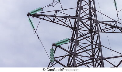 Electric support close-up. Transmission of electricity by wire. Energy industry. Electric power transmission. Glass insulators for high voltage wires