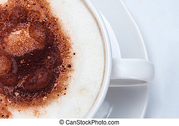 Latte Overhead Close Up on White Table - Overhead shot of...