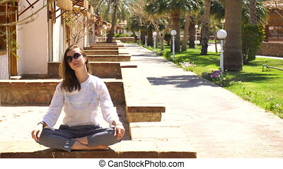 Fashion woman sitting at tropical resort in summer