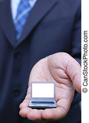 Laptop - Businessman holding a miniature laptop