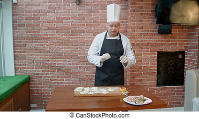 Step by step process of making dumplings, ravioli or pelmeni...