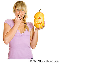 Halloween - A young girl frightened with pumpkin for...