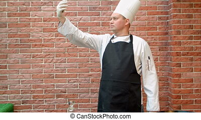 Cook chef making selfie via smartphone in the kitchen....