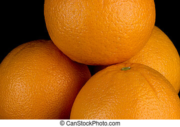 Stack of Oranges on a Black Background - Stack of fresh...