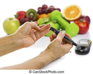 glucometer for glucose level and healthy organic food on a...