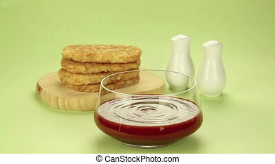 Hash Brown - Hash brown dipped in ketchup with salt and...