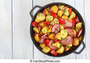 Hash Browns potatoes with ham, top view - delicious Hash...