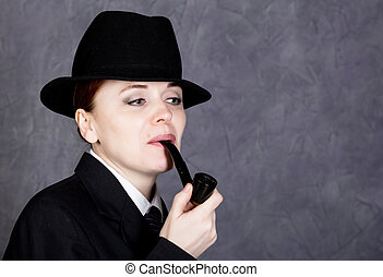 beautiful woman in manly style with smoking pipe on gray...
