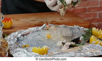 Fresh seafood fall into a plate. Close up. Slow motion....