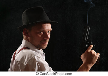 portrait - The aggressive man-gangster with a pistol. A...