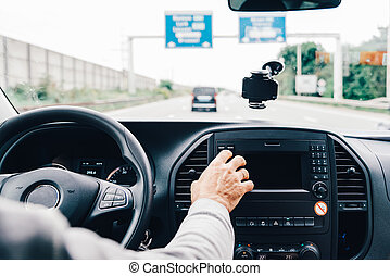 Man driving his car on the freeway
