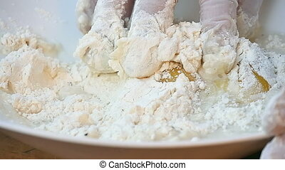 Mixing flour and yeast in the bowl by hand. Close up. Slow...