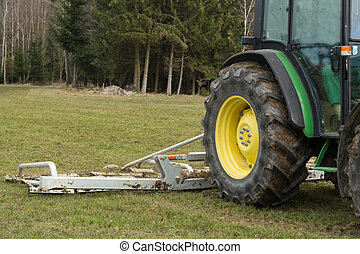 Harrow on the meadow - Harrow with detail of tractor on the...
