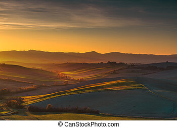 Maremma, rural sunset landscape. Meadows and fields....