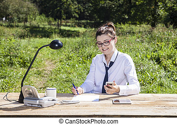 business woman sitting in the office which is on the outside