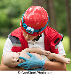 Cpr training on baby dummy