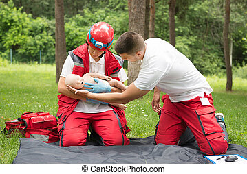 Cpr training on baby dummy - Cpr practice of woman and man...