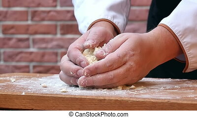 Making dough, kneating in the kitchen. Close up. Slow...