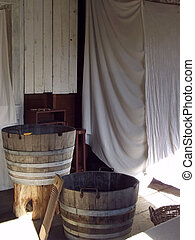 Rustic Laundry House with sheets hanging to dry along side...