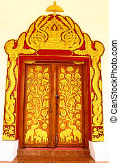 Thai style temple door - Elaborate molding on entrance of...
