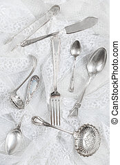 Silverware on a white lace