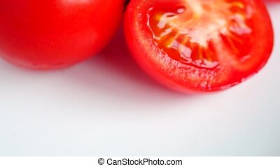 Cut fresh tomato and whole tomatoes pan - Cut-up fresh red...